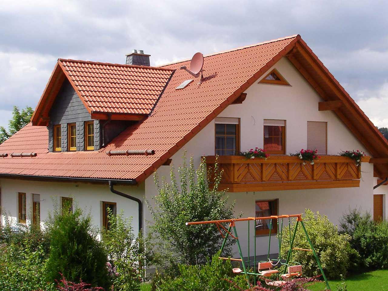 Ferienwohnung Freudensprung - Haus Außenansicht mit Schaukel
